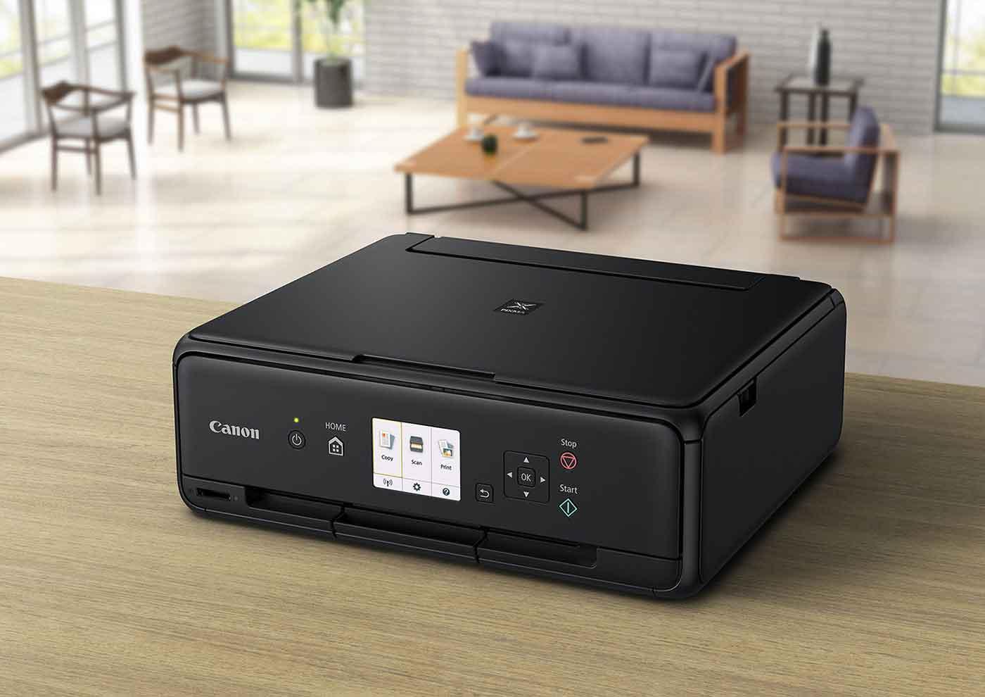 Disfruta de impresiones de alta calidad con las elegantes y compactas impresoras domésticas Tres-en-Uno de Canon